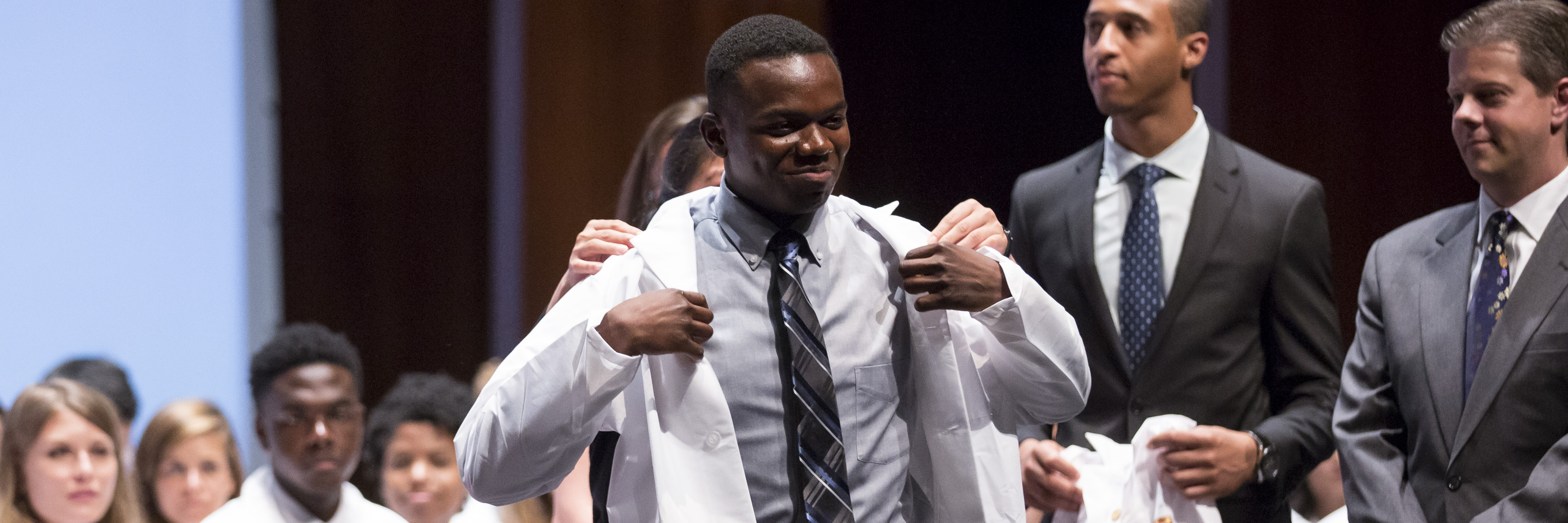 Medical student at white coat ceremony